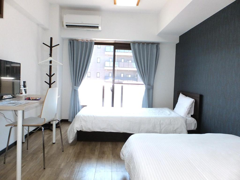 A bed or beds in a room at Stay Ropponmatsu