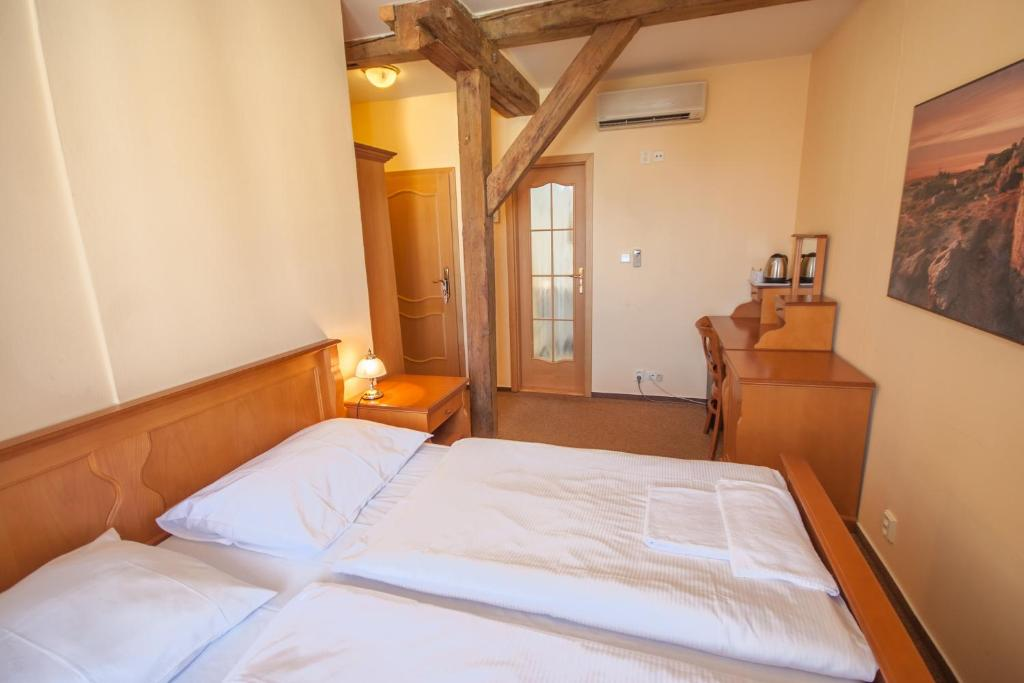 A bed or beds in a room at Brezina Pension