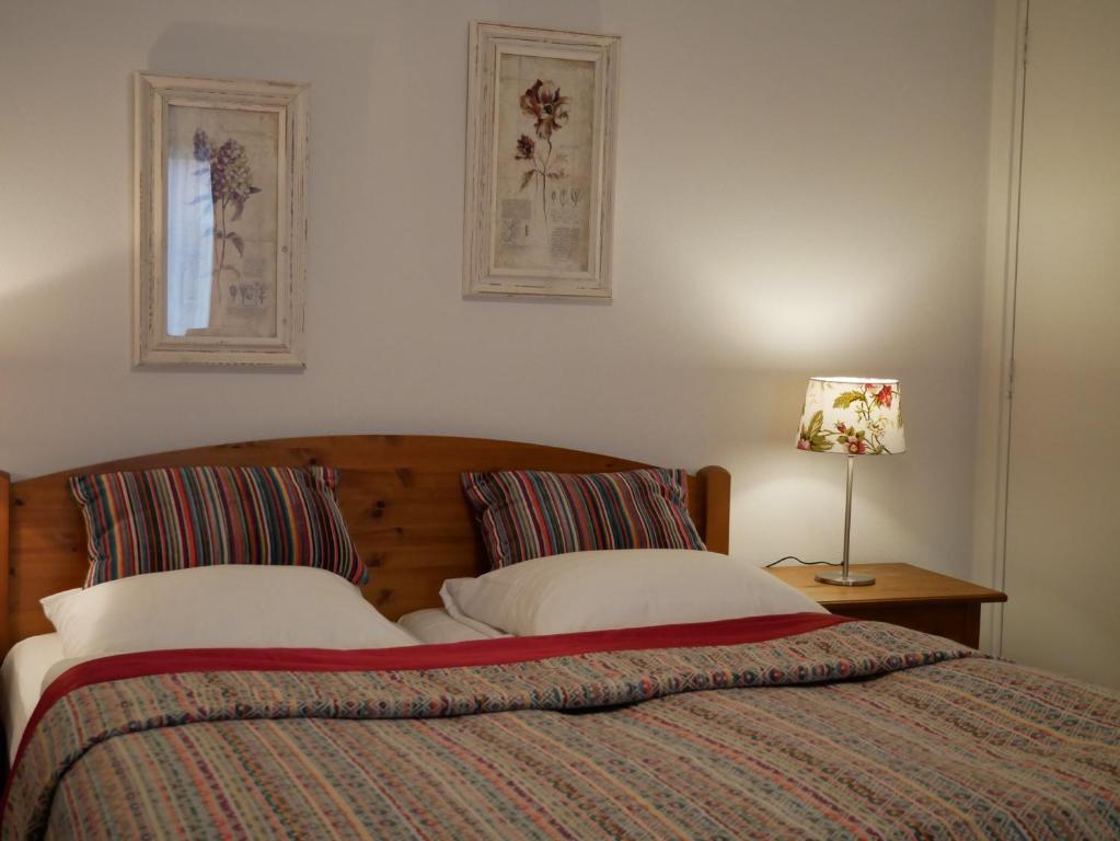 Säng eller sängar i ett rum på De Strandloper