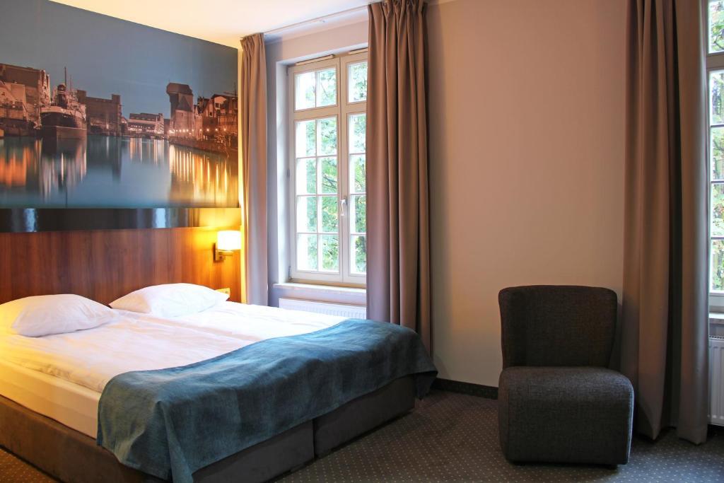 Ein Bett oder Betten in einem Zimmer der Unterkunft Apart Neptun