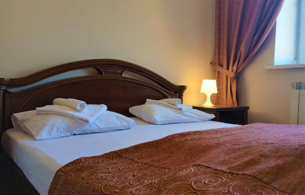 A bed or beds in a room at Lowcost hotel Berison Hudyakova