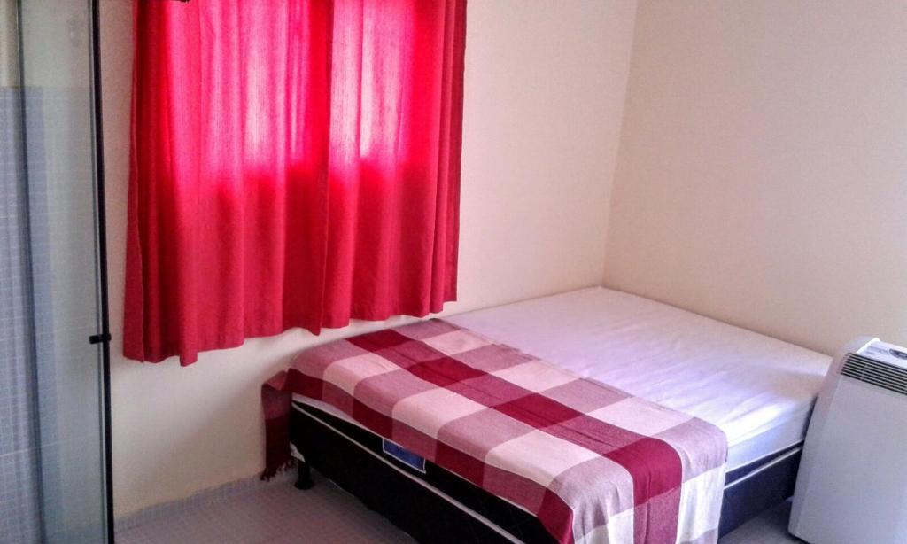Een bed of bedden in een kamer bij POUSADA AGUAS CRISTALINAS