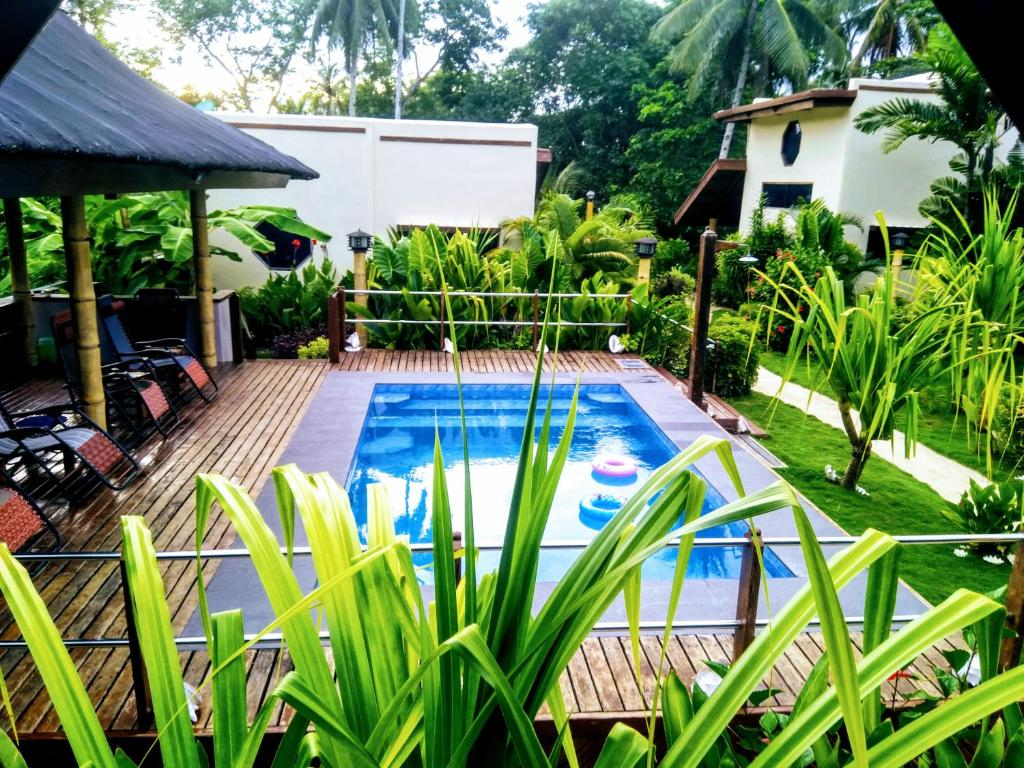 The swimming pool at or near Siargao Sunset Bay Beach Villas