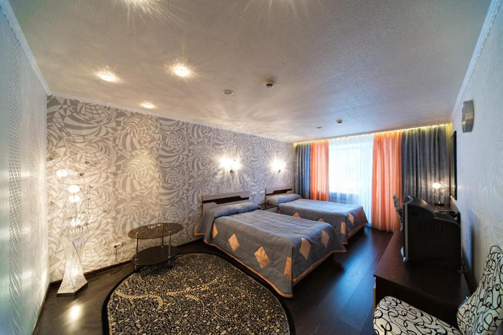 Кровать или кровати в номере Гостиница Шведка