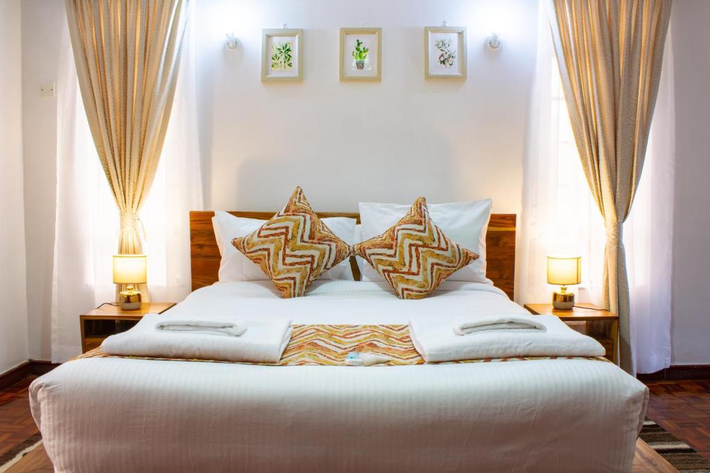 Cama o camas de una habitación en Restead Stay Apartments