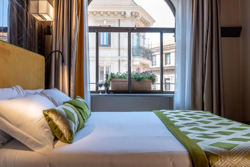 מיטה או מיטות בחדר ב-NEMAN Maison Experience I Pantheon