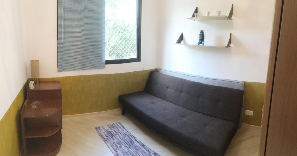 A seating area at Cama e Café Mila
