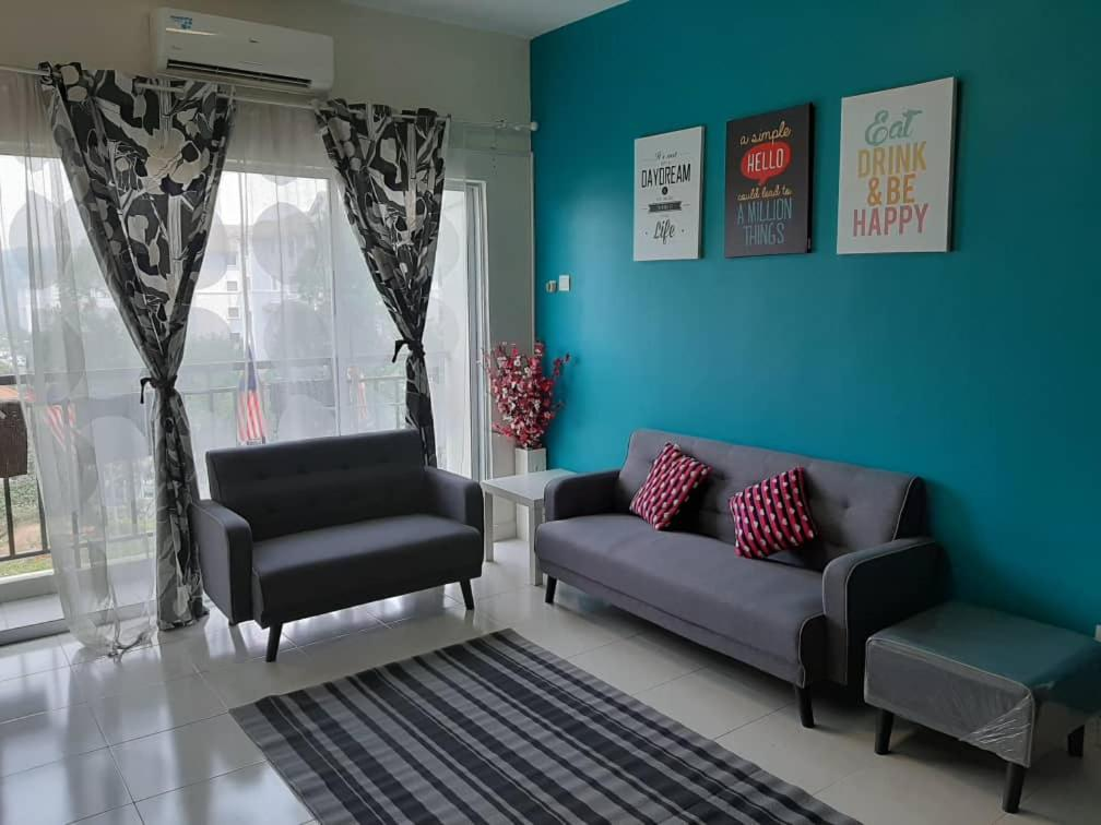 A seating area at Homestay Puncak Alam Residensi Allamanda