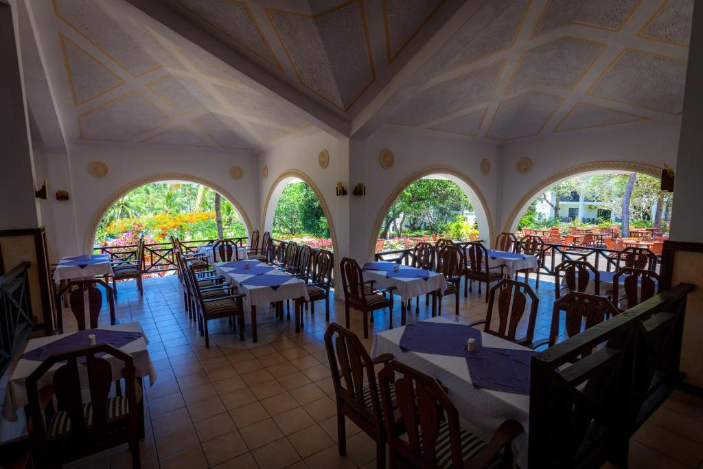 A restaurant or other place to eat at Diani Sea Resort - All Inclusive