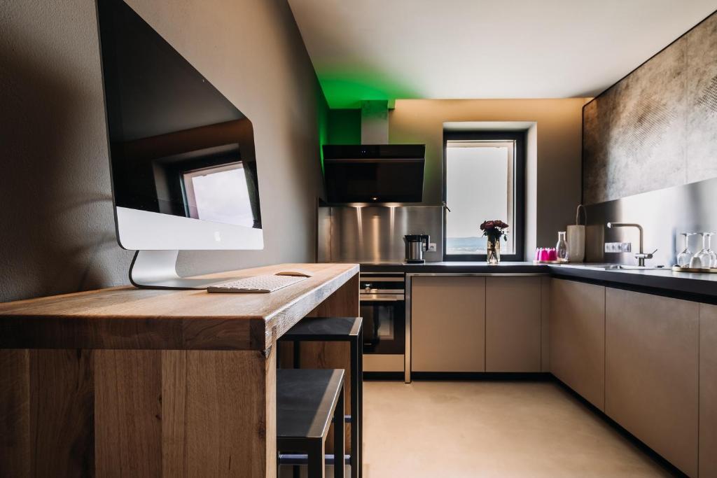 Kuchyň nebo kuchyňský kout v ubytování VILLA BRICOLA - Boutique Apartments