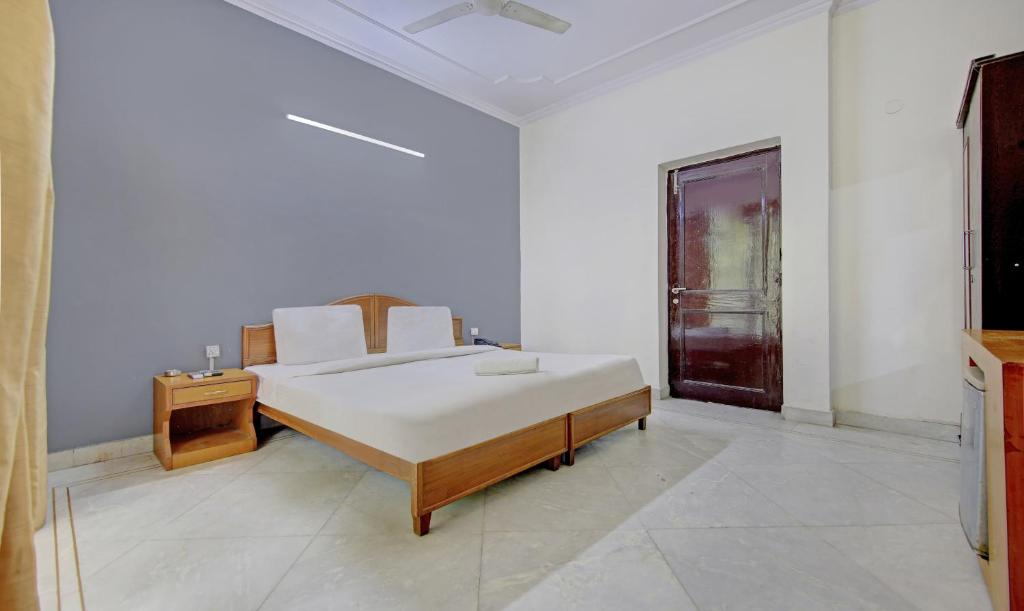 A bed or beds in a room at Annus Holidays