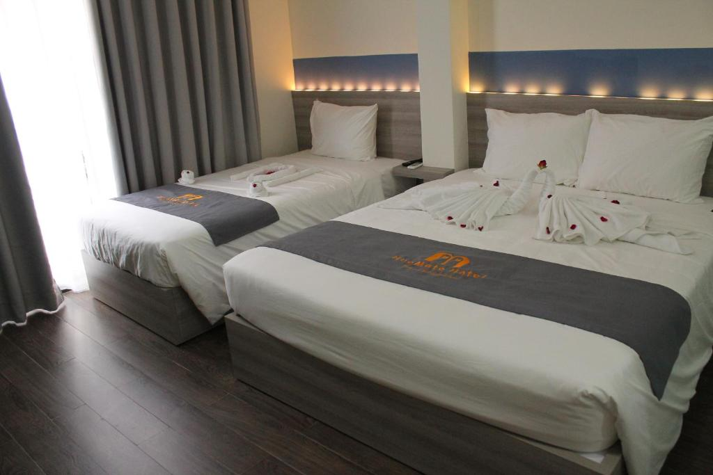A bed or beds in a room at Hue Mate Hotel
