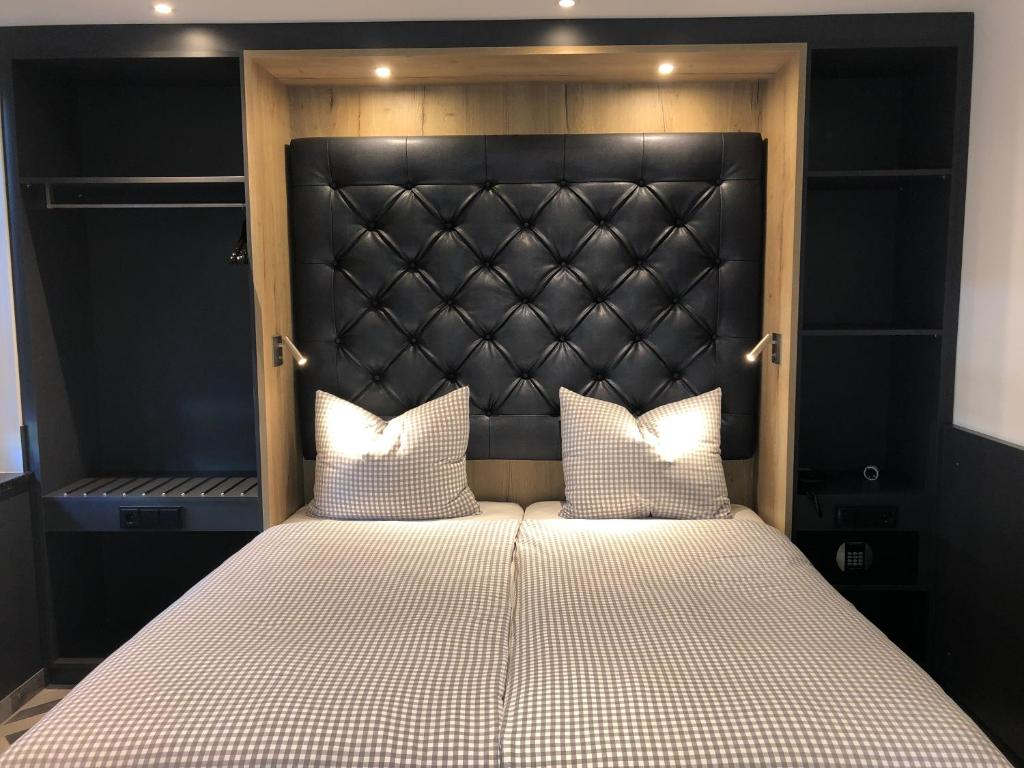 A bed or beds in a room at Munich Deluxe Hotel