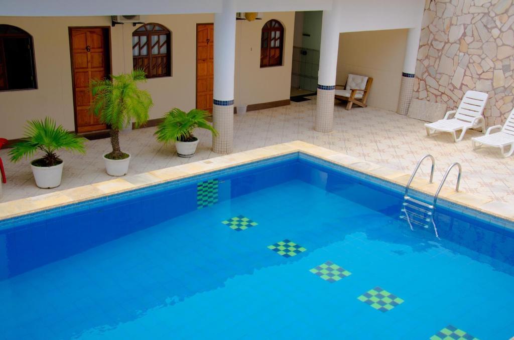 A piscina localizada em Pousada Novo Tempo ou nos arredores
