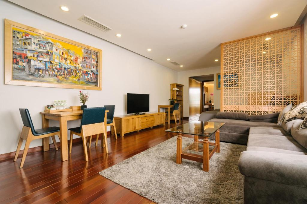 A seating area at Zody Premium Apartment