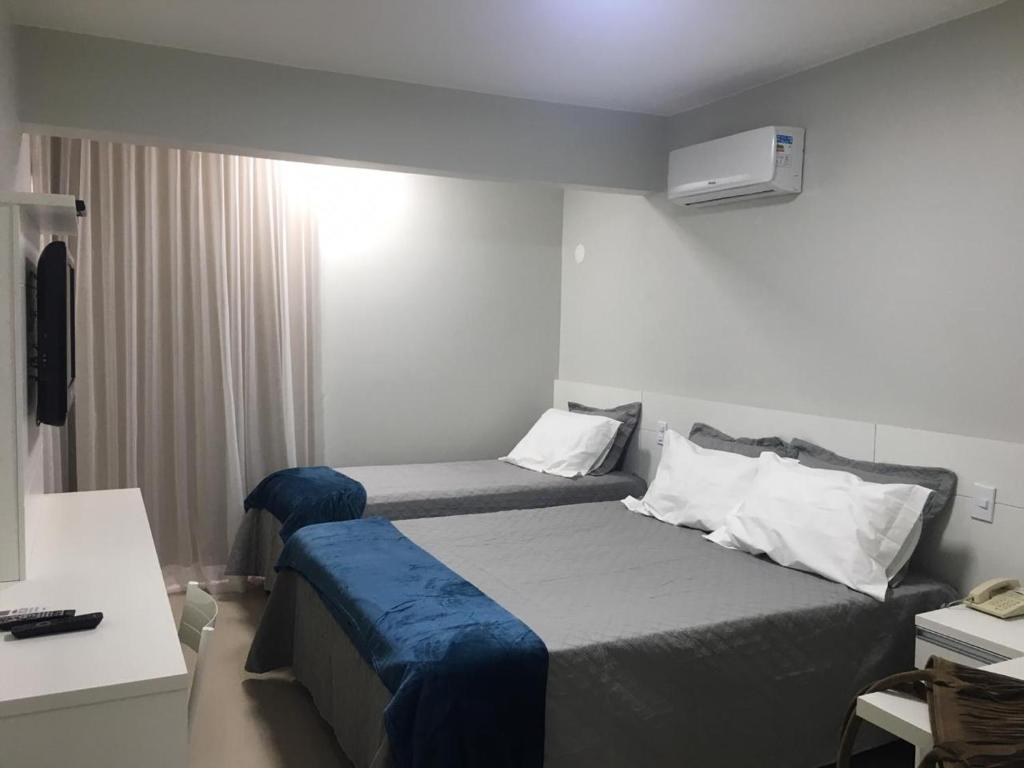 A bed or beds in a room at Sian Apart Hotel Garvey
