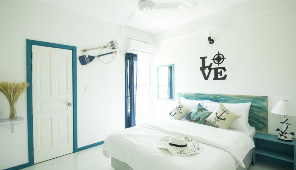 Кровать или кровати в номере The Aquzz