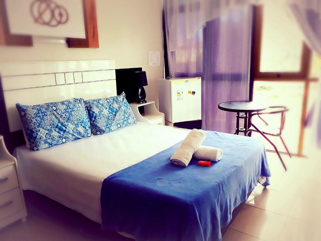 Cama ou camas em um quarto em Pousada Grega