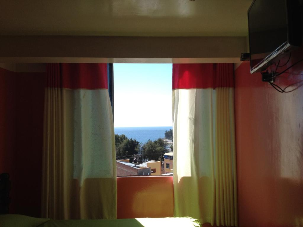 A television and/or entertainment center at Hostal Luis