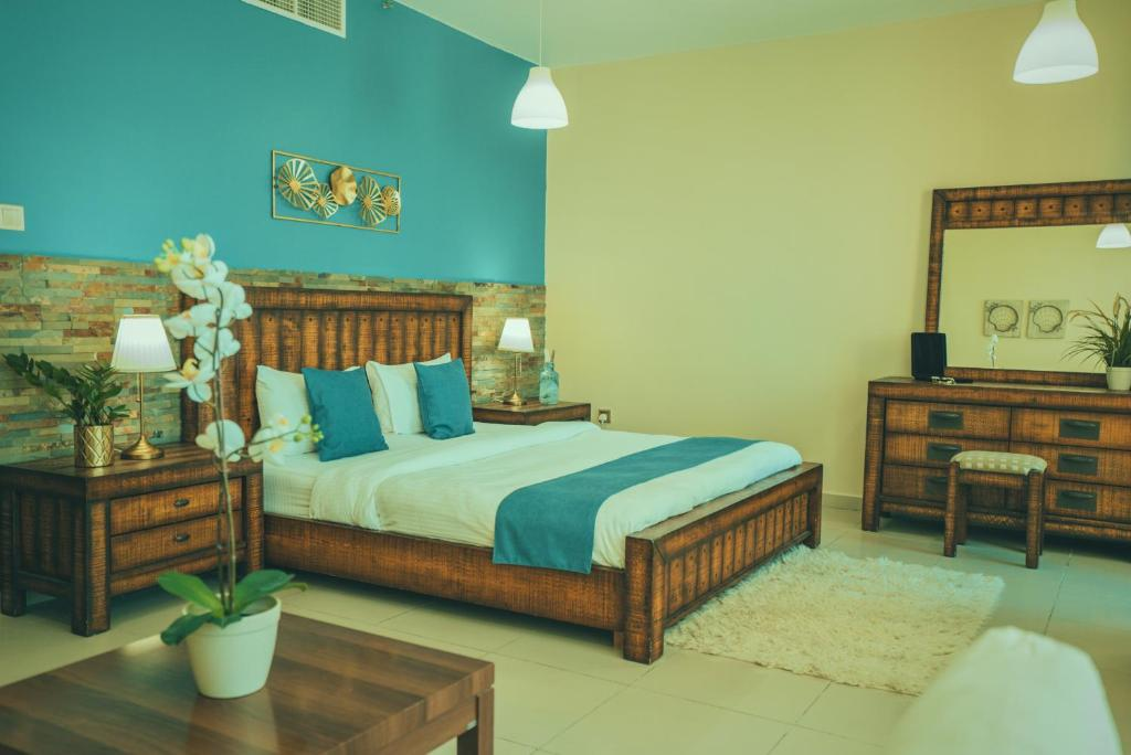 A bed or beds in a room at A C Pearl Holiday Homes - Sea and Palm view Three Bedroom Apartment