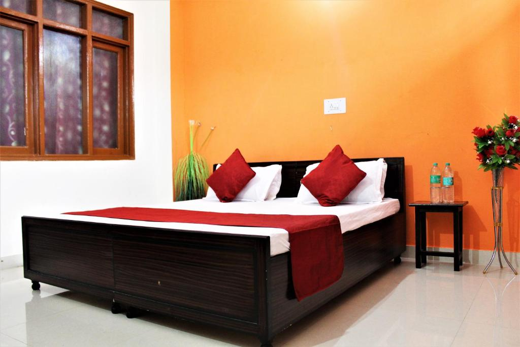 A bed or beds in a room at Krishna Homestay