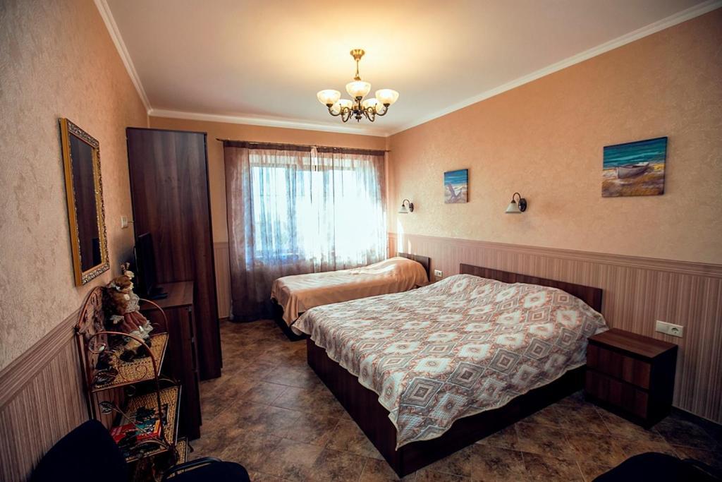 Кровать или кровати в номере Guest House Azovsky Bereg