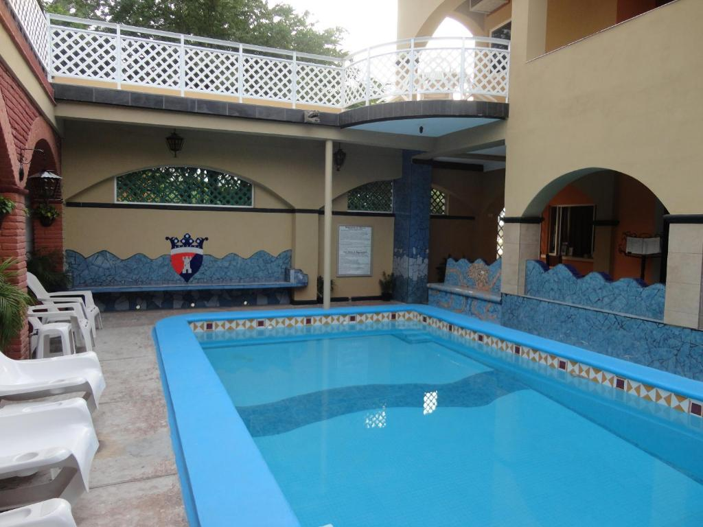 The swimming pool at or near Hotel Posada del Rey