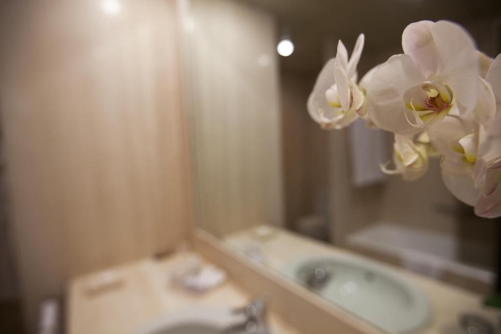 Een badkamer bij Palace Hotel