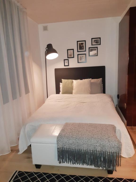 Voodi või voodid majutusasutuse Uue Maailma Apartment toas