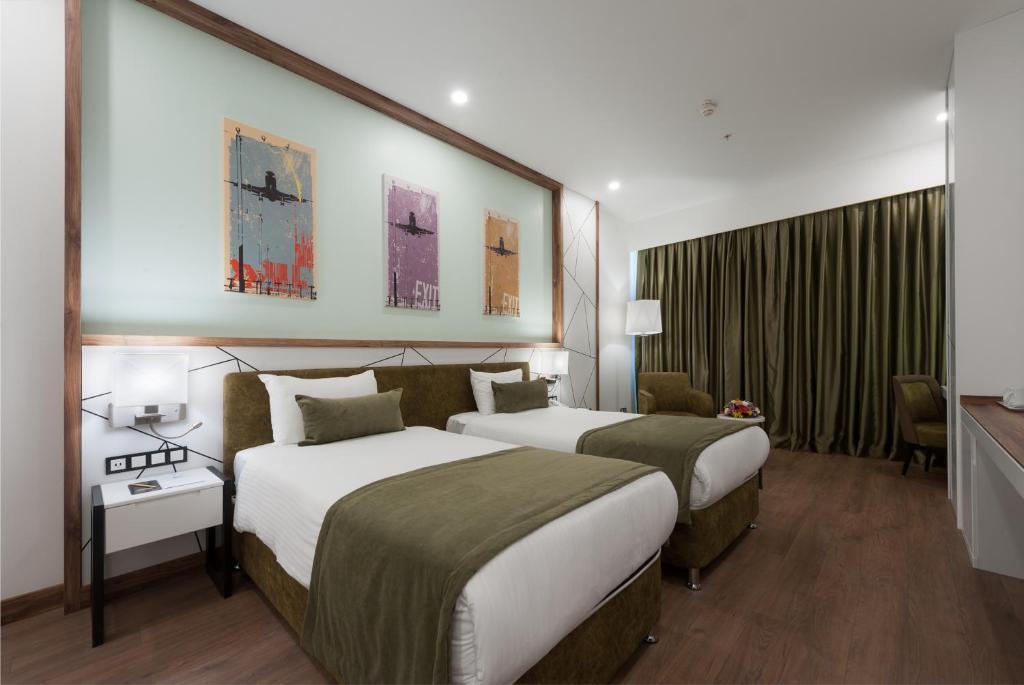 Кровать или кровати в номере ISG Sabiha Gökçen Airport Hotel