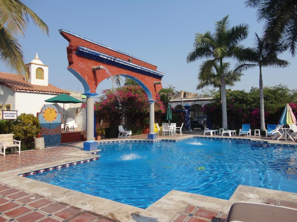 The swimming pool at or near Hotel Hacienda Flamingos