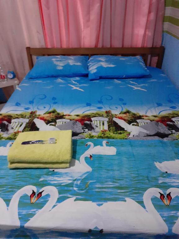 Tempat tidur dalam kamar di Petite Amies