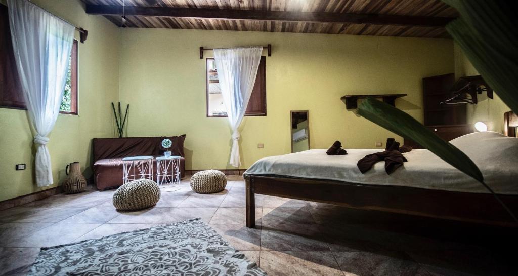 Un ou plusieurs lits dans un hébergement de l'établissement Patio Colonial
