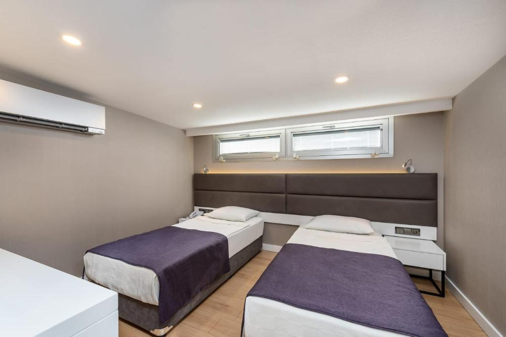 Кровать или кровати в номере KAILA BEACH HOTEL All Inclusive