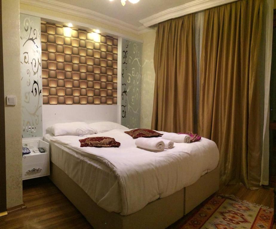 Кровать или кровати в номере Art City Hotel Istanbul