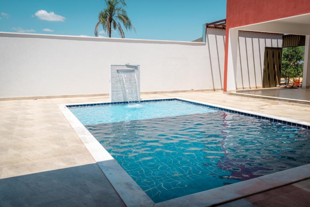 The swimming pool at or close to POUSADA RECANTO DAS VERTENTES