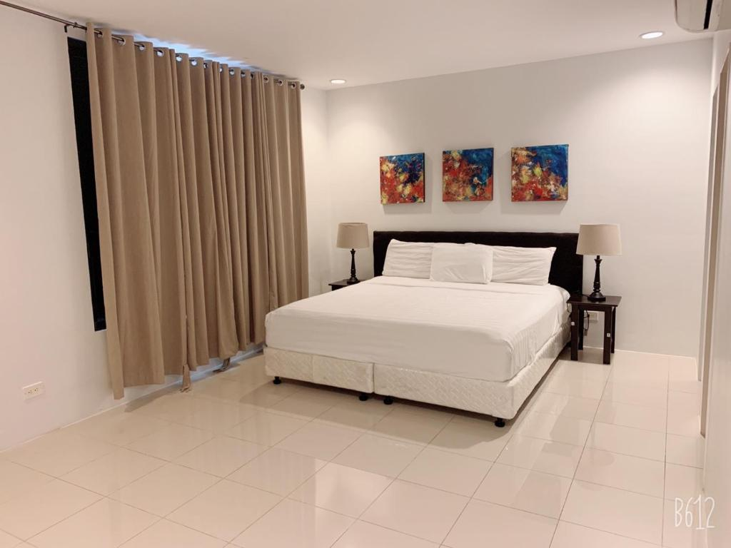 A bed or beds in a room at Tumon Bel-Air Serviced Residence