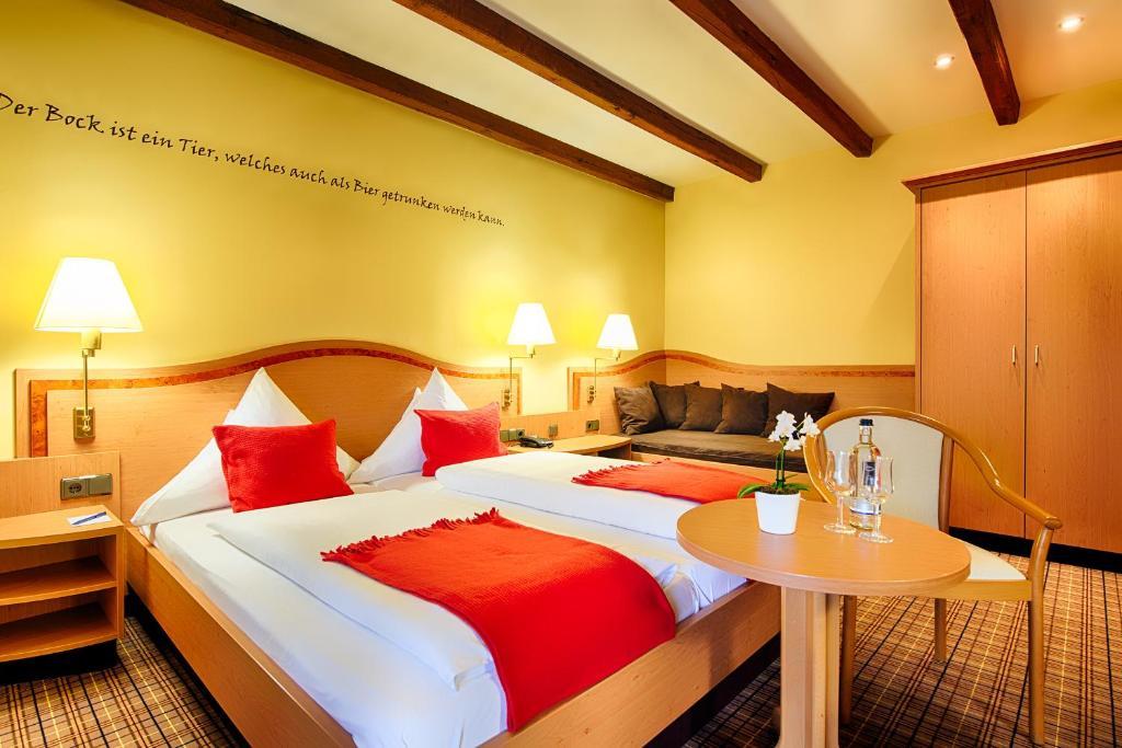 Ein Bett oder Betten in einem Zimmer der Unterkunft Welcome Hotel Dorf Münsterland