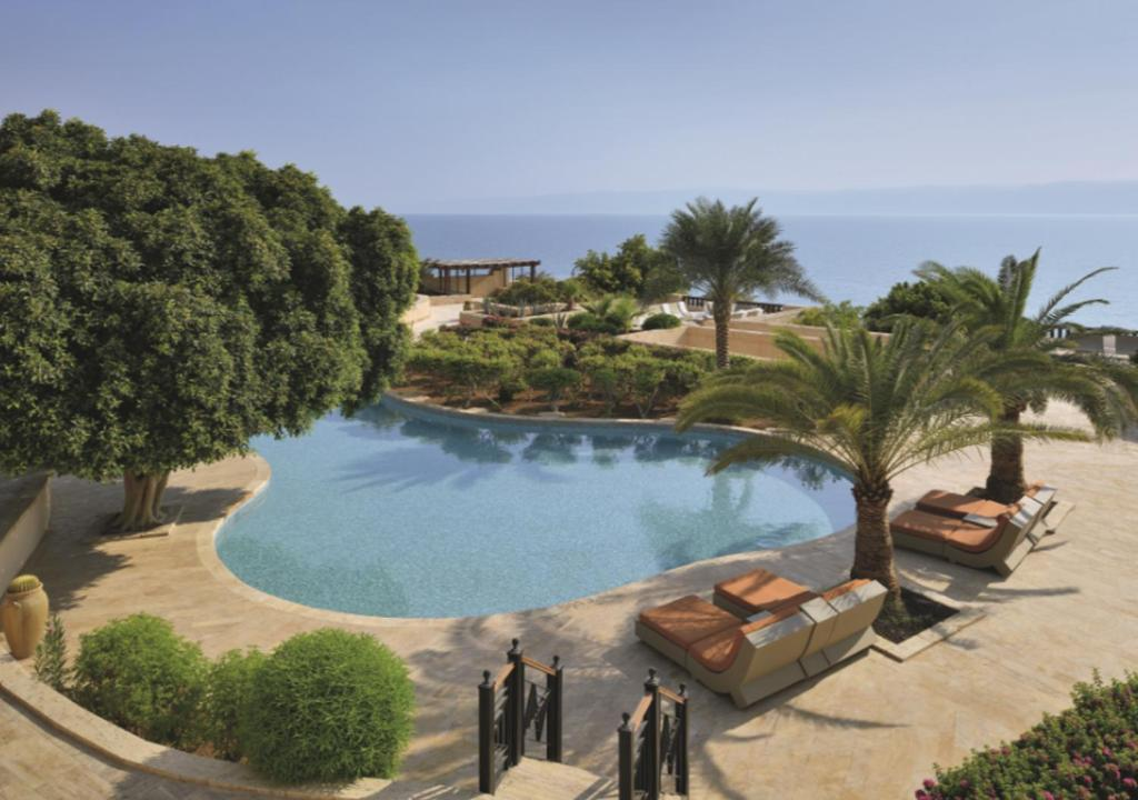 The swimming pool at or near Mövenpick Resort & Spa Dead Sea