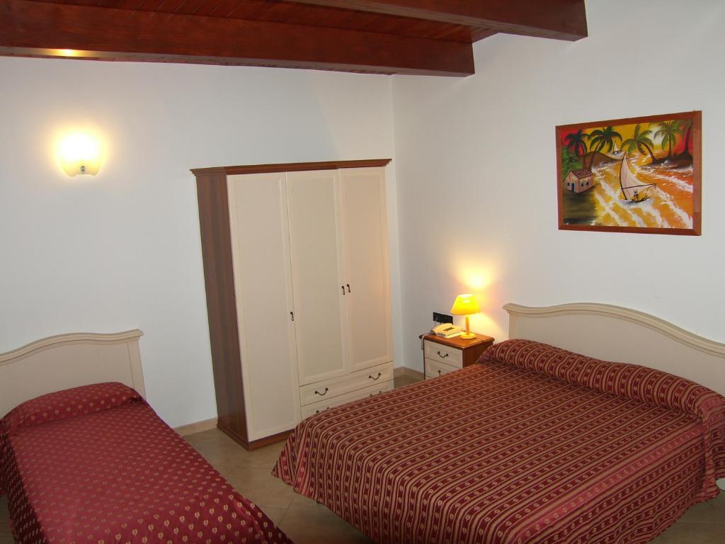 Ένα ή περισσότερα κρεβάτια σε δωμάτιο στο Hotel Genius