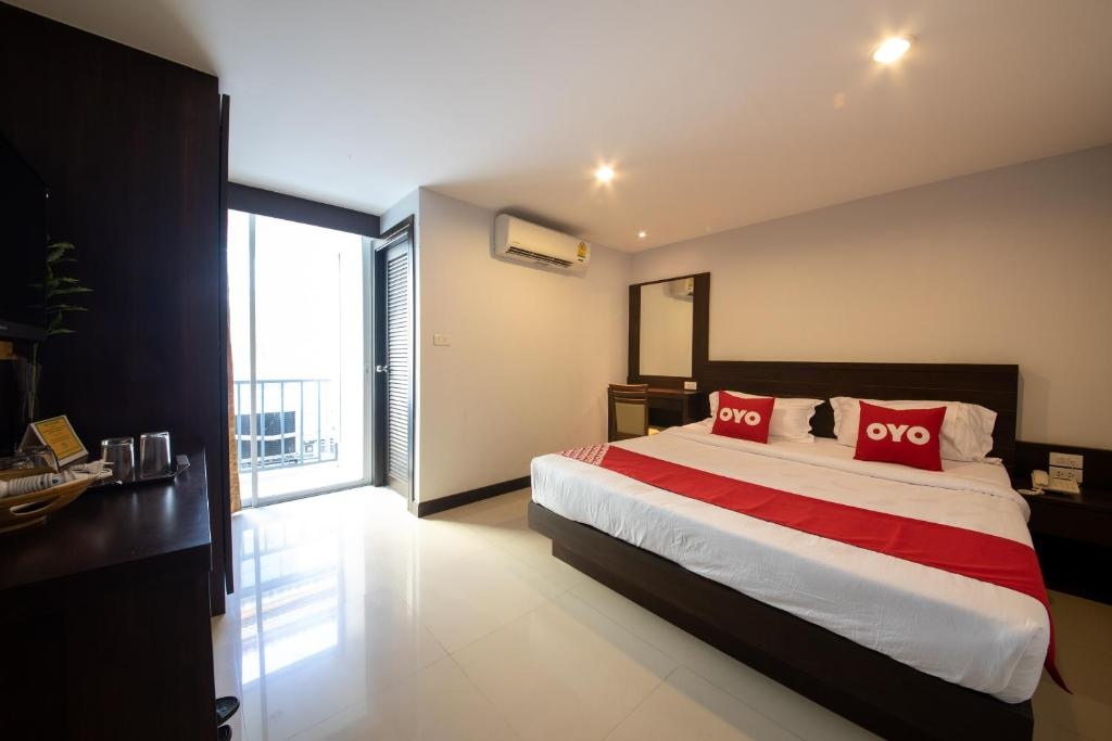 A bed or beds in a room at OYO 373 Mc Ginger House