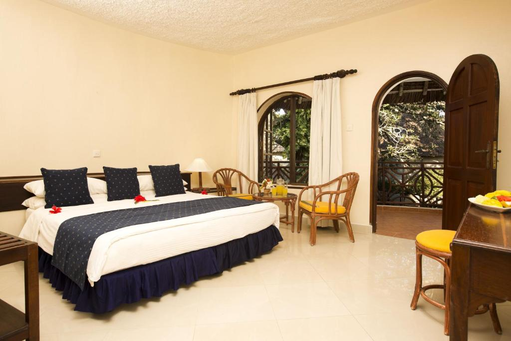 A bed or beds in a room at Neptune Paradise Beach Resort & Spa - All Inclusive