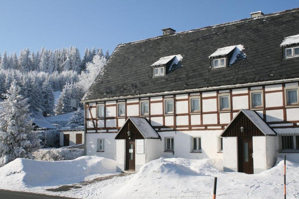 Ferienhaus Am Skihang during the winter