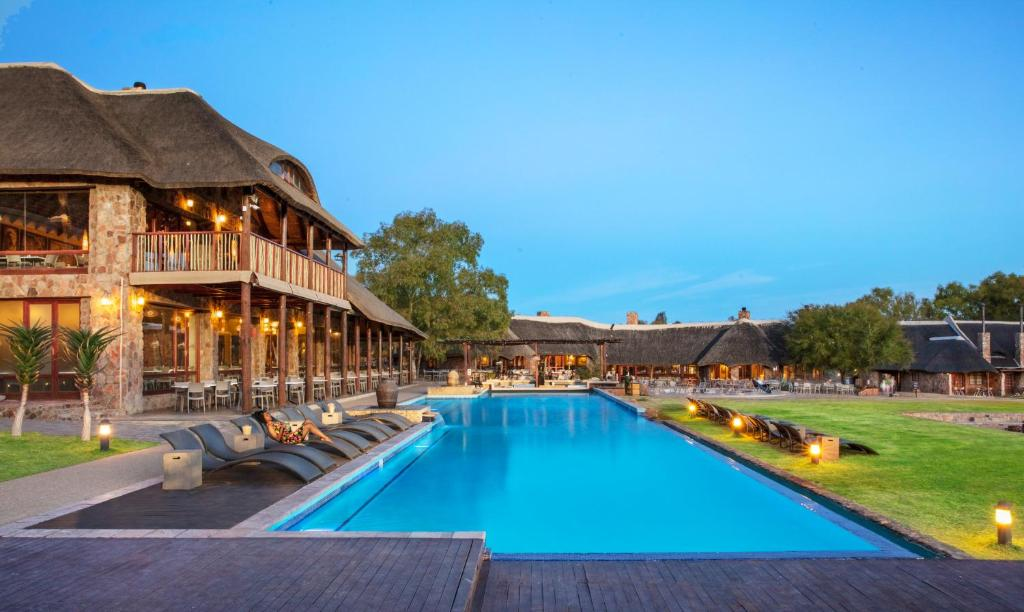 The swimming pool at or near Aquila Private Game Reserve & Spa