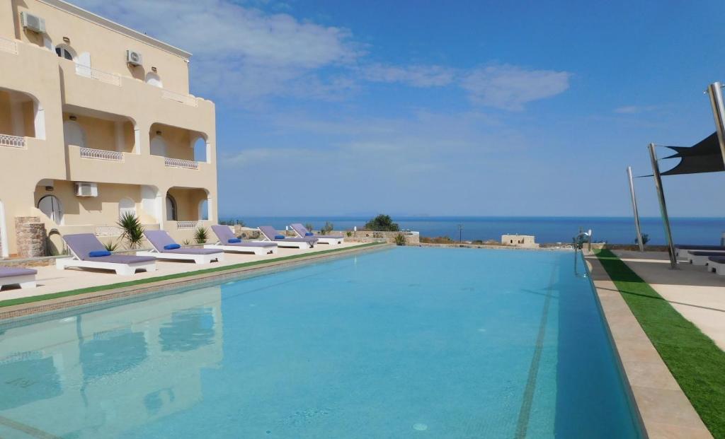 The swimming pool at or near Fira Blue Horizon
