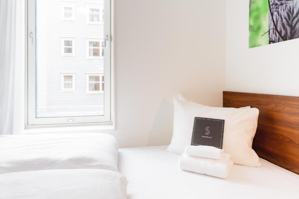 Lova arba lovos apgyvendinimo įstaigoje Smarthotel Tromsø