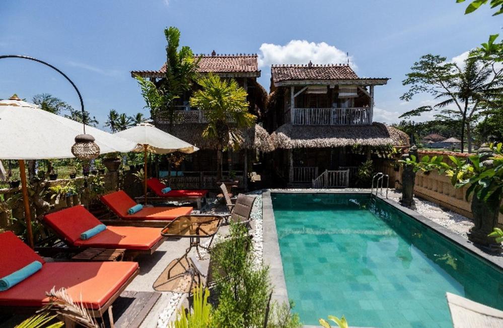 The swimming pool at or close to Royal JJ Ubud Resort & Spa