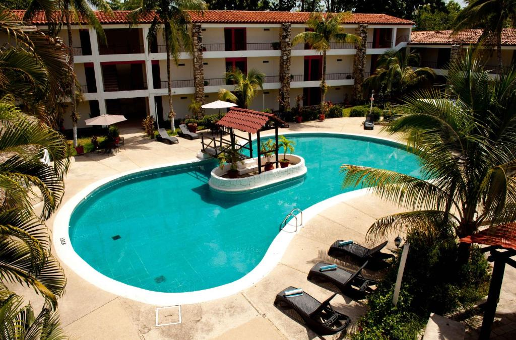 A view of the pool at Plaza Palenque Hotel & Convention Center or nearby