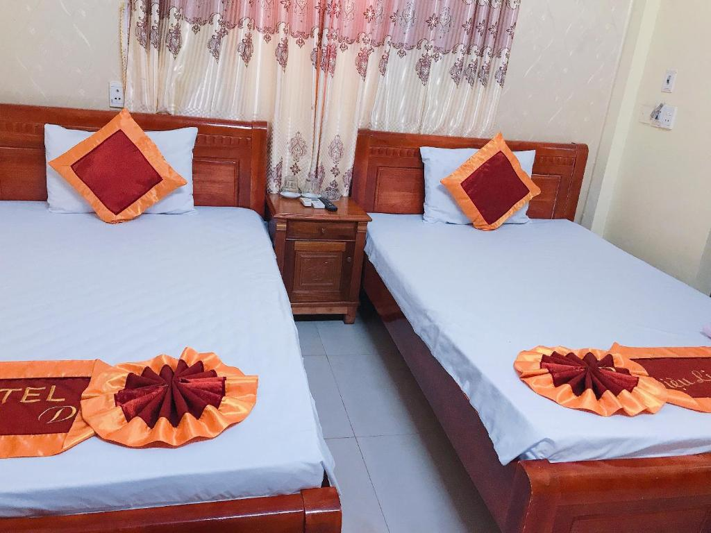 A bed or beds in a room at Magic Dieu Linh Hotel
