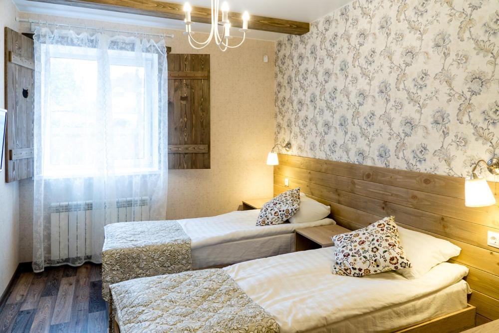 Кровать или кровати в номере Гостевой дом Три кота